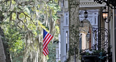 View of American flag hanging on building in downtown Savannah.